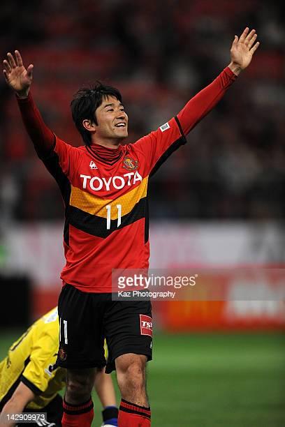 Keiji Tamada of Nagoya Grampus celebrates scoring the third goal during the J.League match between Nagoya Grampus and Consadole Sapporo at Toyota...