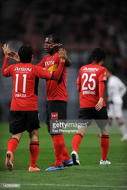 Keiji Tamada of Nagoya Grampus celebrates scoring the third goal with his teammates Luis Danilson Cordoba Rodrigues during the J.League match between...