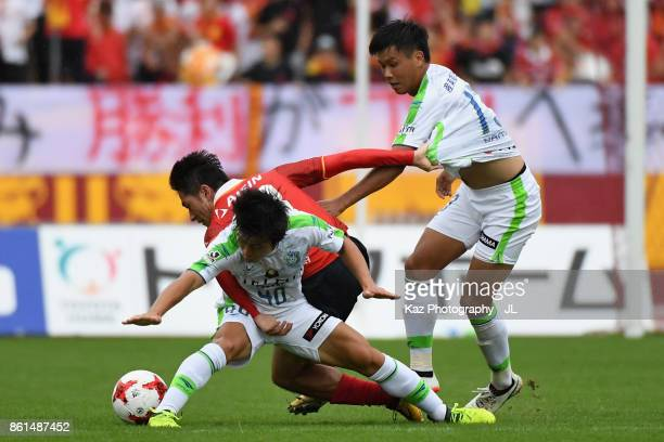 Keiji Tamada of Nagoya Grampus competes for the ball against Temma Matsuda and Miki Yamane of Shonan Bellmare during the J.League J2 match between...