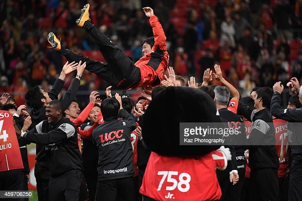 Keiji Tamada of Nagoya Grampus is lifted by his team mates as he leaves the team during the JLeague match between Nagoya Grampus and Omiya Ardija at...