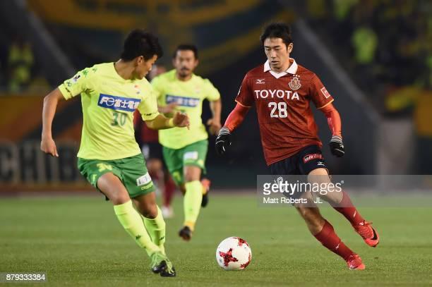 Keiji Tamada of Nagoya Grampus takes on Yushi Mizobuchi of JEF United Chiba during the JLeague J1 Promotion PlayOff semi final match between Nagoya...