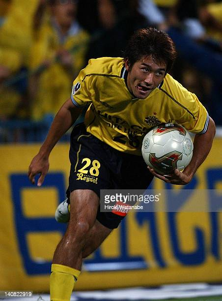 Keiji Tamada picks up the ball from the back of the net after scoring the first goal during the JLeague match between Kashiwa Reysol and Gamba Osaka...