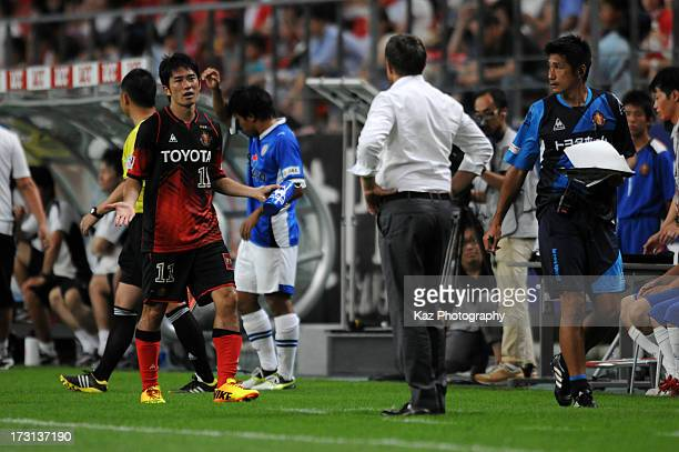 Keiji Tamada reacts after being replaced during the JLeague match between Nagoya Grampus and Shimizu SPulse at Toyota Stadium on July 6 2013 in...