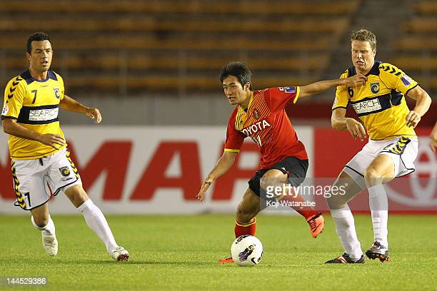 Keiji Tamada#11 of Nagoya Grampus and Patrick Zwaanswijk of Central Coast compete for the ball during the AFC Asian Champions League Group G match...
