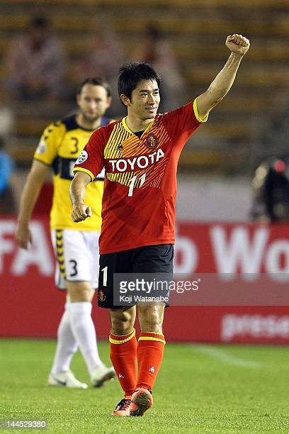 Keiji Tamada#11 of Nagoya Grampus celebrates the first goal during the AFC Asian Champions League Group G match between Nagoya Grampus and Central...