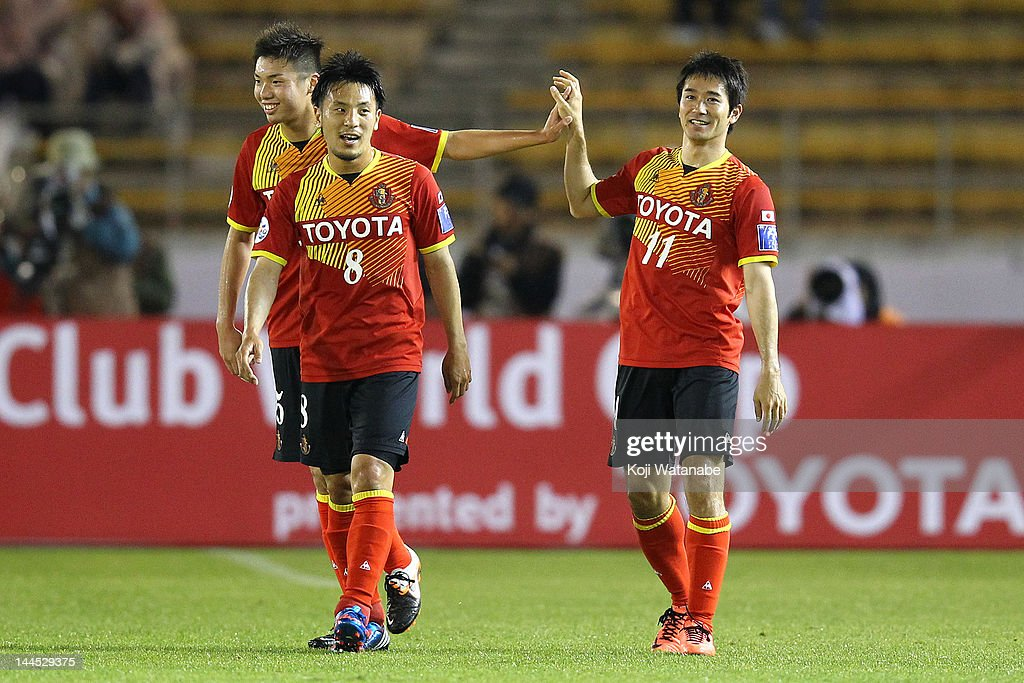 Keiji Tamada#11 of Nagoya Grampus celebrates the first goal with Jungo Fujimoto #8 during the AFC Asian Champions League Group G match between Nagoya Grampus and Central Coast Mariners at Mizuho Athletic Stadium on May 15, 2012 in Nagoya, Japan.