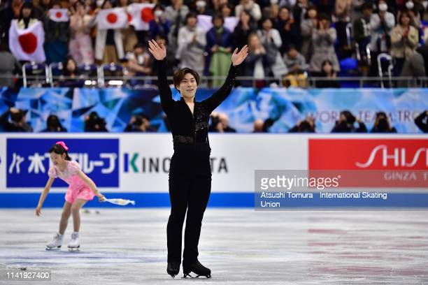 Keiji Tanaka of Japan applauds fans after competing in the Men's Single Short Program on day one of the ISU Team Trophy at Marine Messe Fukuoka on...