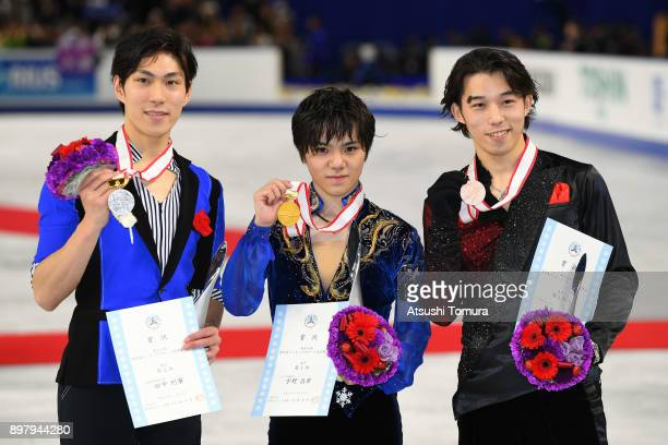 Keiji Tanaka Shoma Uno and Takahito Mura of Japan pose with their medals after competing in the men free skating during day four of the 86th All...