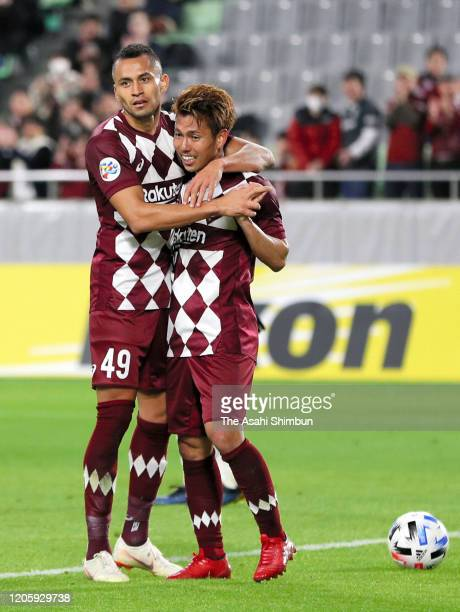 Keijiro Ogawa of Vissel Kobe is congratulated by his team mate Douglas after scoring his side's fifth and hat trick goal during the AFC Champions...