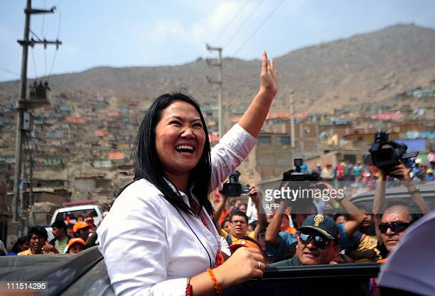 Keiko Fujimori daughter of Peru's former President Alberto Fujimori waves to the crowd after a conference to announce her candidacy for Peru's...