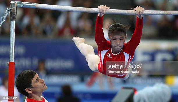 Keiko Mukumoto of Japan performs on the uneven bars during the women's qualifications of the 40th World Artistic Gymnastics Championships on...