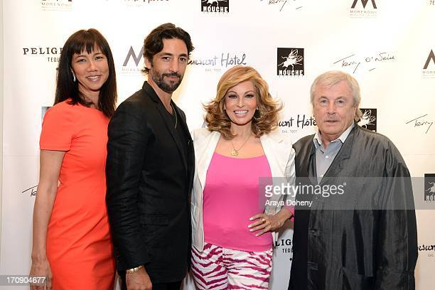 Keiko Noah Arno Elias Raquel Welch and Terry O'Neill attend a gallery exhibit of Terry O'Neill Presents The Opus A 50 Year Retrospective at Mouche...