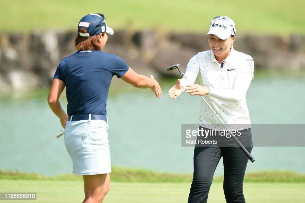 Keiko Sasaki and Miki Uehara of Japan shake hands afetr holing out on the 18th green during the final round of the Castol Ladies at Fuji Ichihara...