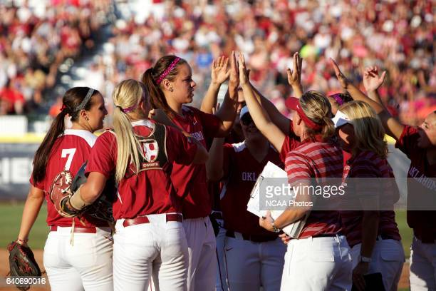 Keilani Ricketts of the University of Oklahoma is congratulated after the end of an inning against the University of Alabama during the Division I...