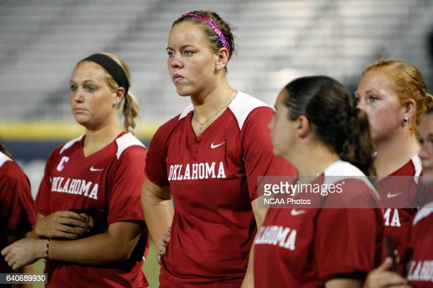 Keilani Ricketts of the University of Oklahoma looks on as the University of Alabama celebrates their victory during the Division I Women's Softball...