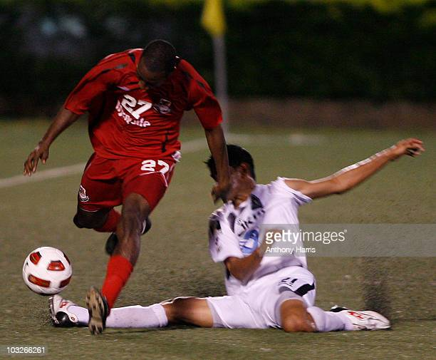 Keilor Soto of Costa Rica's Brujas FC vies for the ball with Micah Lewis of Joe Public of Triniddad and Tobago during their match as part of 2010...
