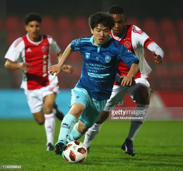 Keina Yamaguchi of Excelsior U19 battles for the ball with Jurrien Timber of Ajax during the YOUTH CUP U19 between Ajax U19 and Excelsior U19 at...