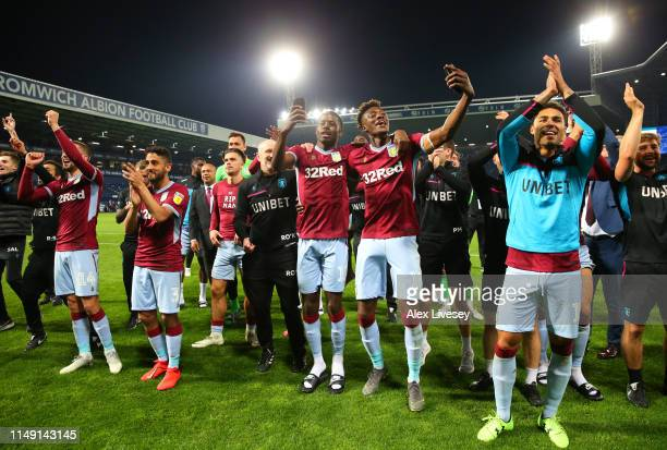 Keinan Davis and Tammy Abraham of Aston Villa celebrate victory in the penalty shoot out with team mates after the Sky Bet Championship Playoff semi...
