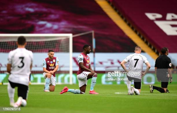 Keinan Davis of Aston Villa and John Lundstram of Sheffield United take a knee in support of the Black Lives Matter movement prior to the Premier...