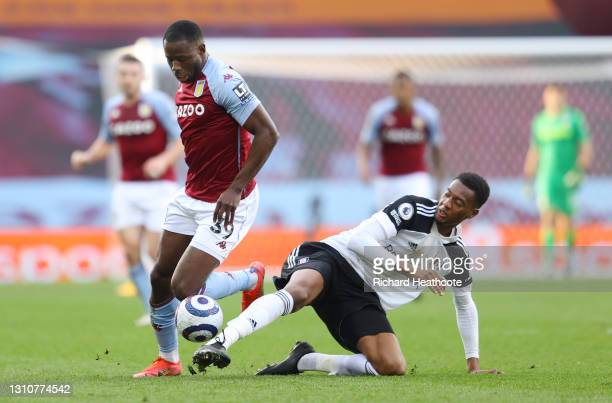 Keinan Davis of Aston Villa and Tosin Adarabioyo of Fulham battle for possession during the Premier League match between Aston Villa and Fulham at...