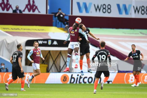 Keinan Davis of Aston Villa battles for possession with in the air with Andreas Christensen of Chelsea during the Premier League match between Aston...