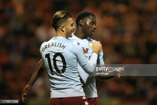 Keinan Davis of Aston Villa celebrates scoring his team's fourth goal with teammate Jack Grealish during the Carabao Cup Second Round match between...