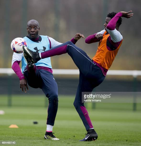 Keinan Davis of Aston Villa in action with team mate Chris Samba during a training session at the club's training ground at Bodymoor Heath on March...