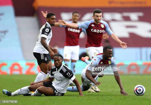 Keinan Davis of Aston Villa is challenged by Joshua Onomah of Fulham during the Premier League match between Aston Villa and Fulham at Villa Park on...