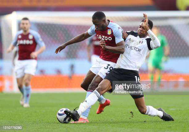 Keinan Davis of Aston Villa is challenged by Tosin Adarabioyo of Fulham during the Premier League match between Aston Villa and Fulham at Villa Park...