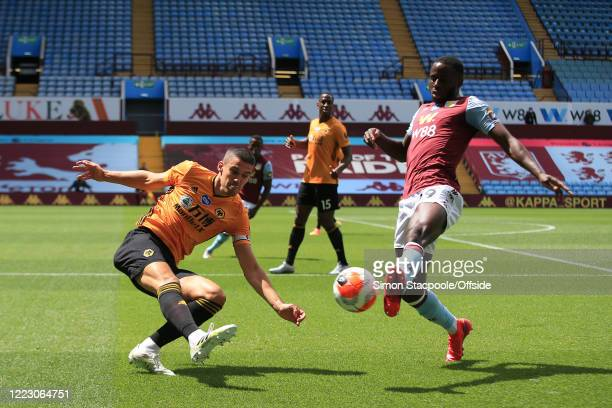Keinan Davis of Villa blocks a clearance from Conor Coady of Wolves during the Premier League match between Aston Villa and Wolverhampton Wanderers...