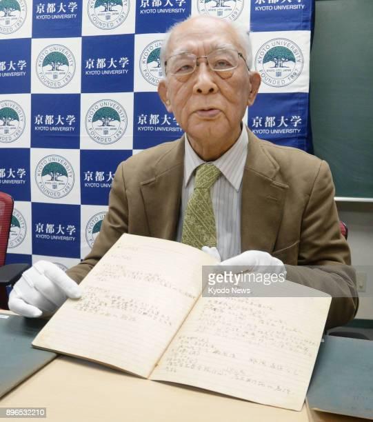 Keio University Professor Emeritus Michiji Konuma holds a diary written by Hideki Yukawa a theoretical physicist and the first Japanese Nobel...