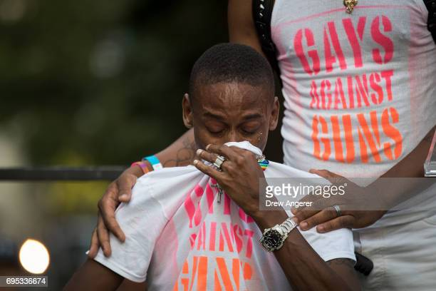 Keion Carter survivor of the 2016 Pulse nightclub shooting breaks down while speaking the audience during a memorial service and rally for the...