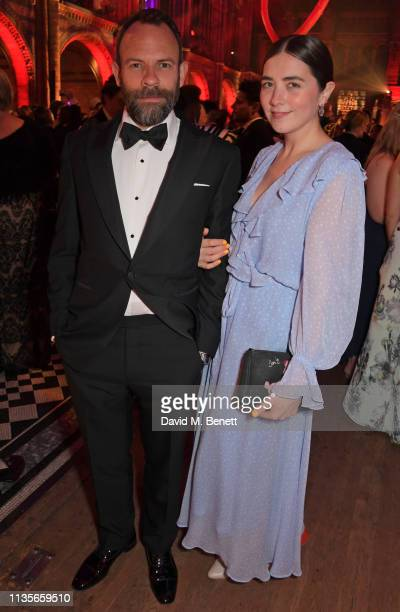Keir Charles and guest attend The Olivier Awards 2019 after party at The Natural History Museum on April 7 2019 in London England