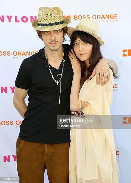 Keir Knight and Irina Lazareanu attend NYLON x BOSS ORANGE Escape House Day 1 at Lake La Quinta Inn on April 13 2013 in La Quinta California