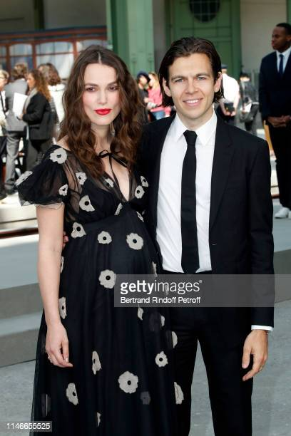 Keira Knightley and James Righton attend the Chanel Cruise Collection 2020 : Front Row at Le Grand Palais on May 03, 2019 in Paris, France.