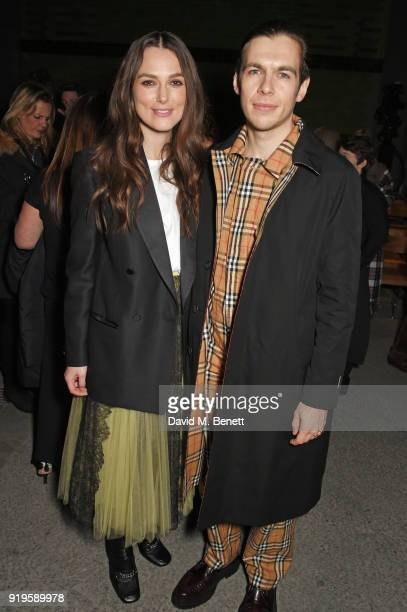 Keira Knightley and James Righton wearing Burberry at the Burberry February 2018 show during London Fashion Week at Dimco Buildings on February 17...