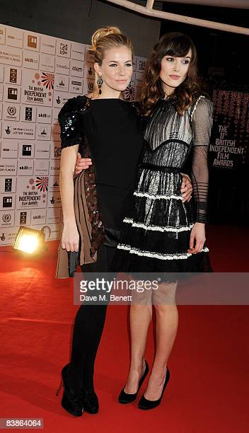 Keira Knightley and Sienna Miller arrive at The British Independent Film Awards 2008 at the Old Billingsgate Market on November 30 2008 in London...