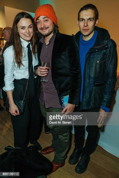 Keira Knightley Tim Phillips and James Righton attend 'The Grinning Man' press night afterparty at Mall Galleries on December 18 2017 in London...