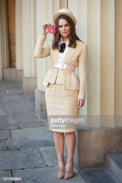 Keira Knightley with her OBE at Buckingham Palace on December 13 2018 in London England