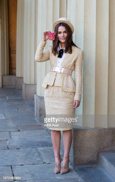 Keira Knightley with her OBE at Buckingham Palace on December 13 2018 in London England at Buckingham Palace on December 13 2018 in London England