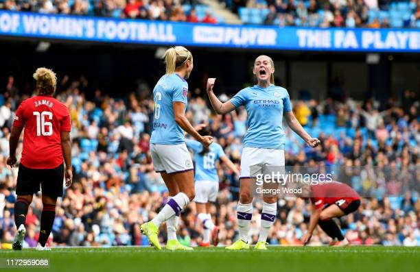Keira Walsh and Steph Houghton of Manchester City celebrate victory after the Barclays FA Women's Super League match between Manchester City and...