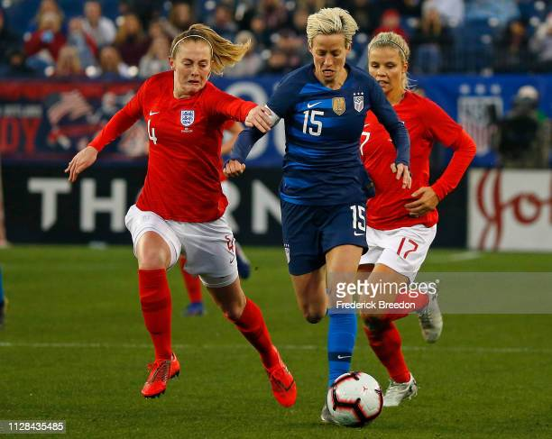 Keira Walsh of England and Megan Rapinoe of the USA chase a ball during the second half of the 2019 SheBelieves Cup match between USA and England at...