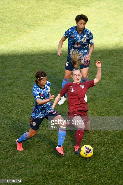 Keira Walsh of England steals the ball from Narumi Miura of Japan as Mina Tanaka of Japan looks on during the first half in the SheBelieves Cup at...