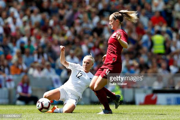 Keira Walsh of England Women is tackled by Betsy Hassett of New Zealand Women during the International Friendly between England Women and New Zealand...