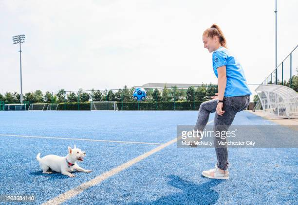 Keira Walsh of Manchester City poses with her dog for International Dog Day on August 26, 2020 in Manchester, England.