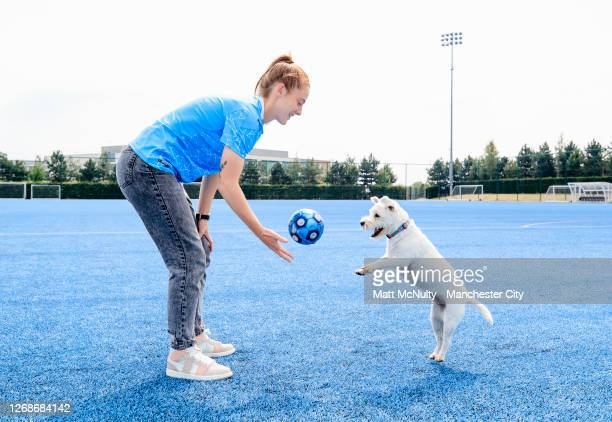 Keira Walsh of Manchester City poses with her dog for International Dog Day on August 26 2020 in Manchester England