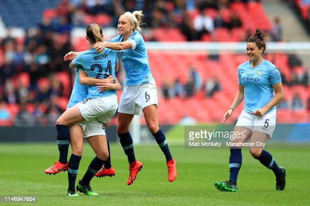 Keira Walsh of Manchester City Women celebrates after scoring her team's first goal with her team mates during the Women's FA Cup Final match between...