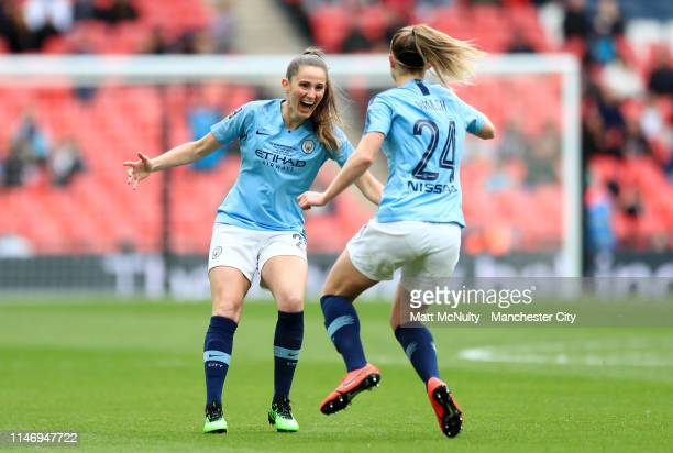 Keira Walsh of Manchester City Women celebrates with teammate Abbie McManus of Manchester City Women after scoring her team's first goal during the...