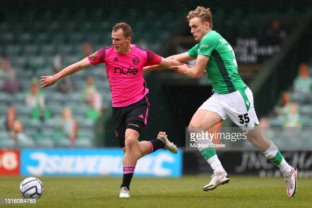Keiran Green of Halifax is challenged by Billy Sass-Davies of Yeovil during the Vanarama National League match between Yeovil Town and F.C Halifax at...