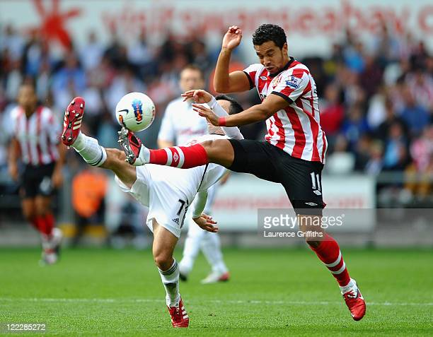 Keiran Richardson of Sunderland battles for the ball with Leon Britton of Swansea City during the Barclays Premier League match between Swansea City...